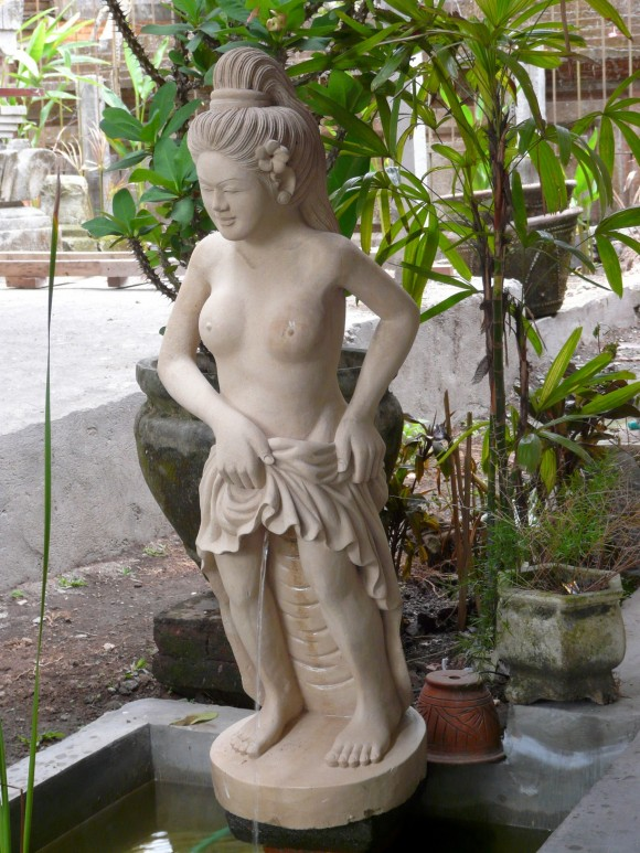 odd signs and statues in Southeast Asia