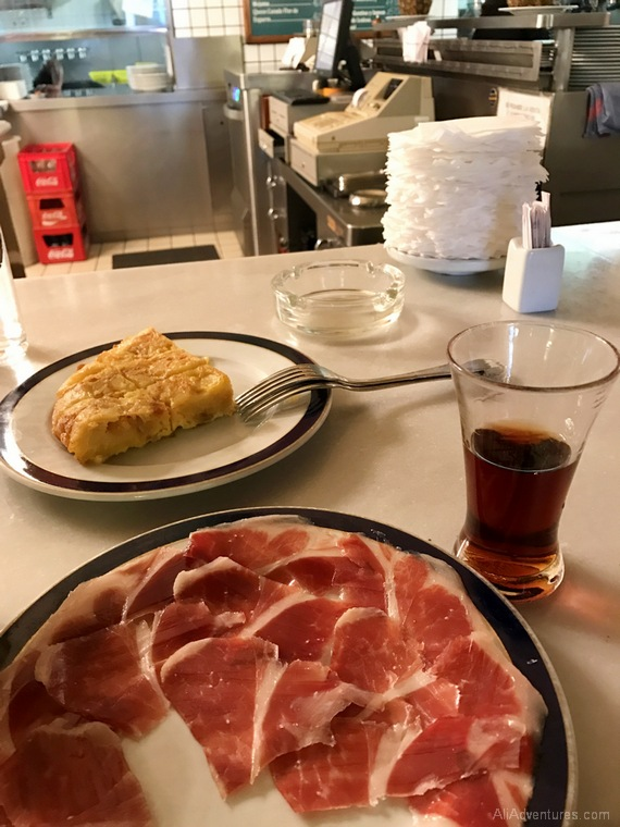 what to eat in Madrid - Madrid food tour ham and vermouth